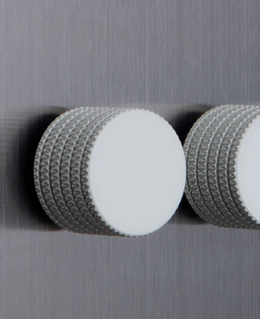 closeup of silver and white triple dimmer switch