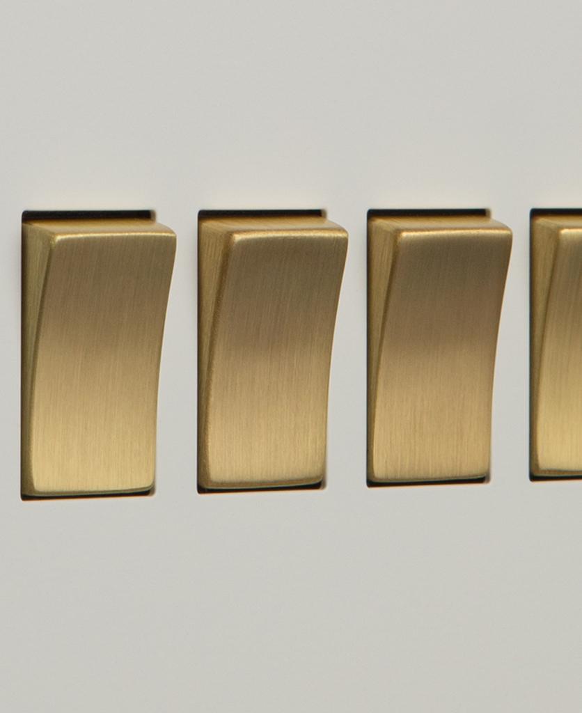 white and gold 4g quadruple rocker switch close up