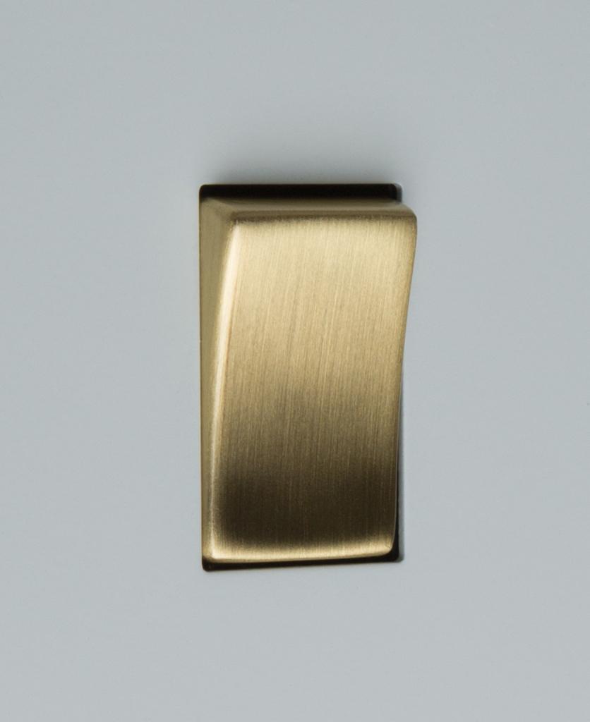 white and gold 1g single rocker switch close up