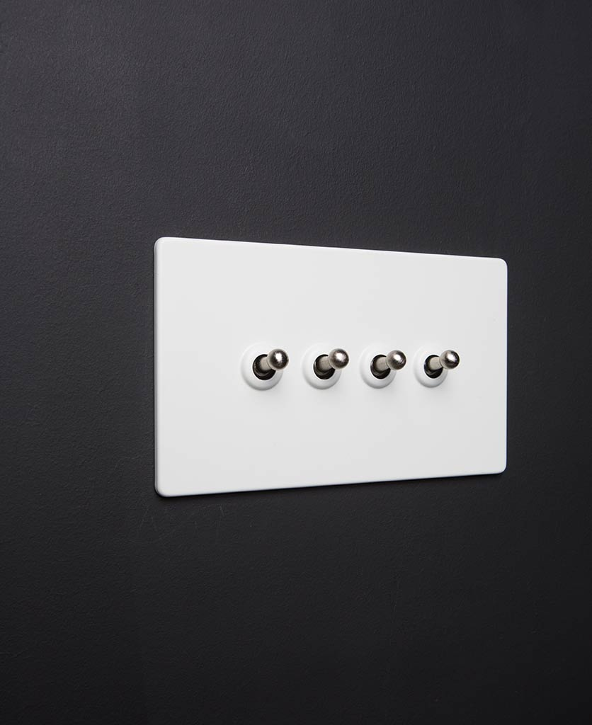 White LED toggle switch with quad black toggle detail