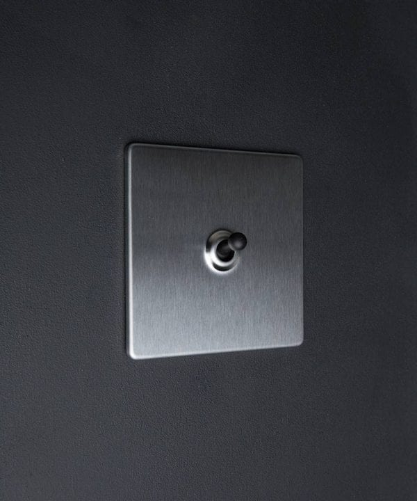 silver & black single toggle light switch
