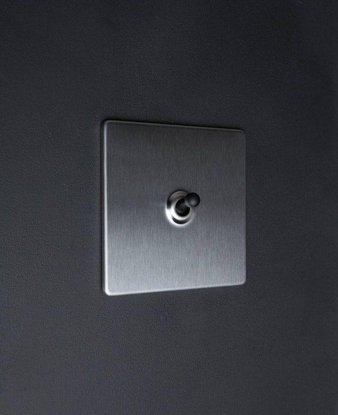 silver & black single toggle light switch
