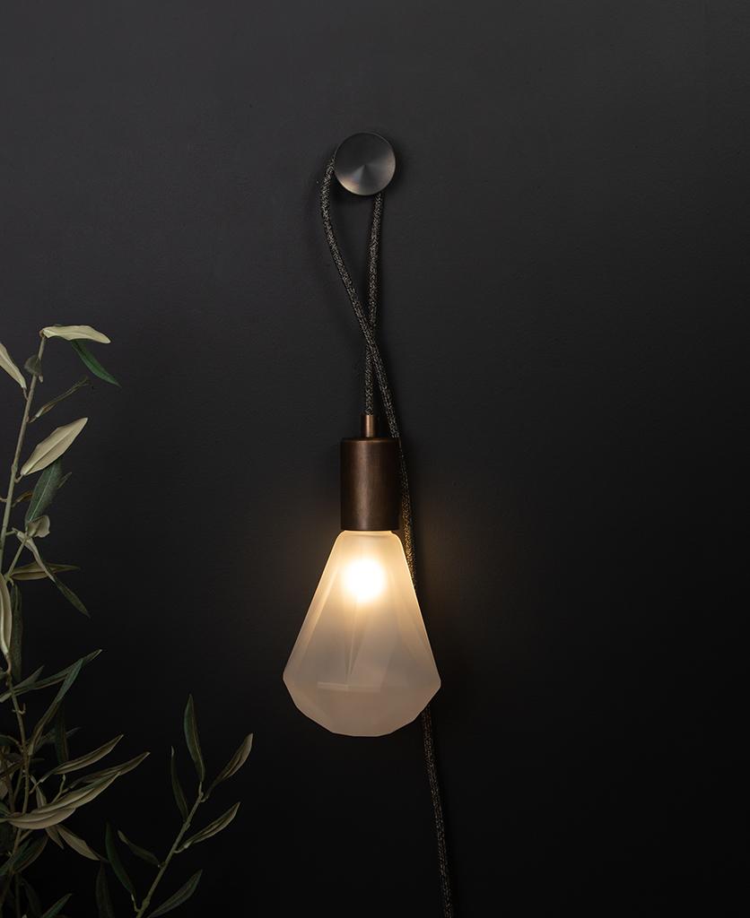 keren wall mounted lamp against black background