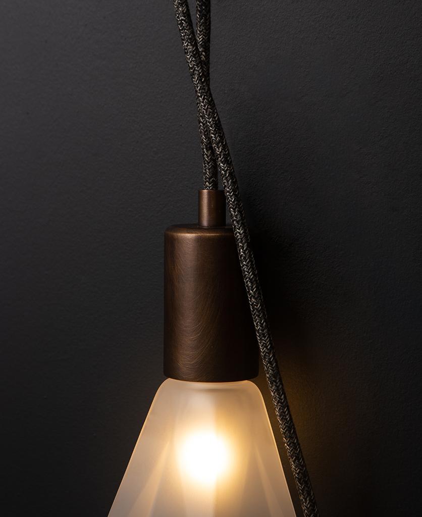 Keren wall lamp closeup against black background