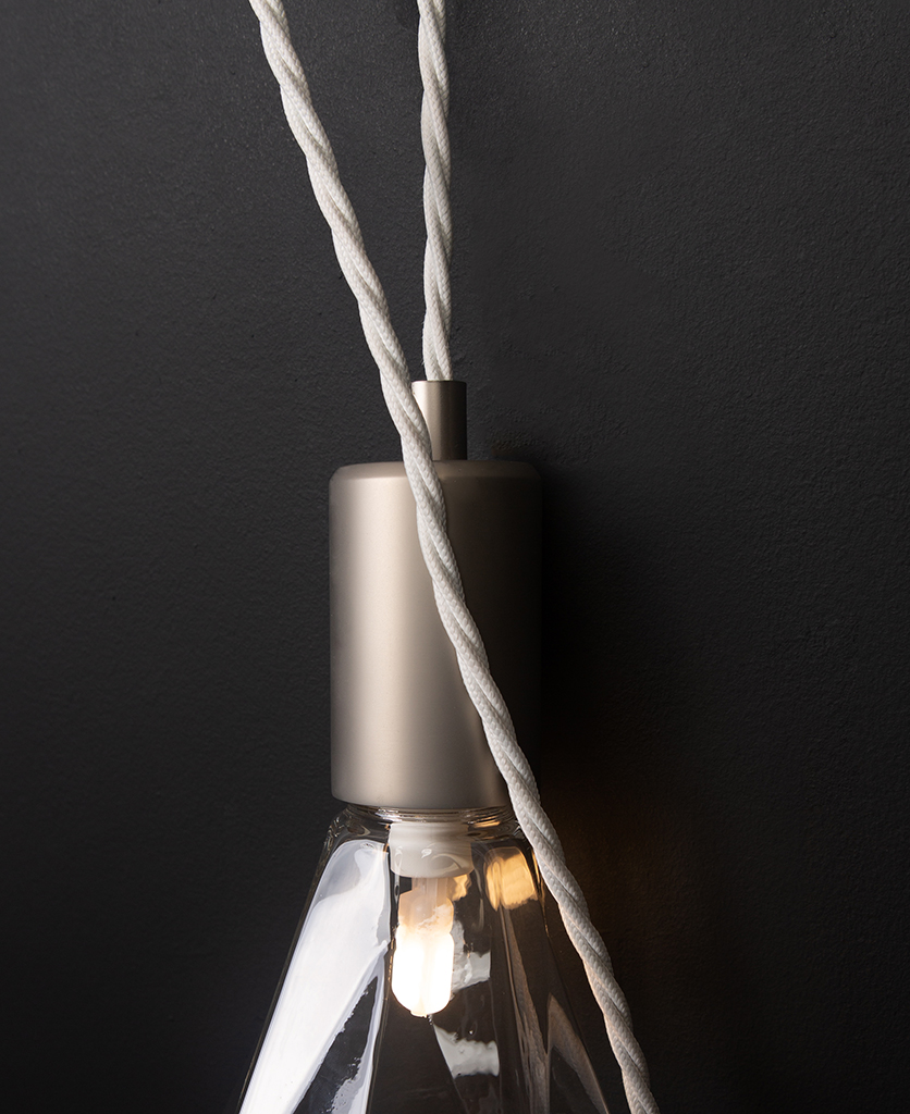 closeup danni christalle wall lamp against black background
