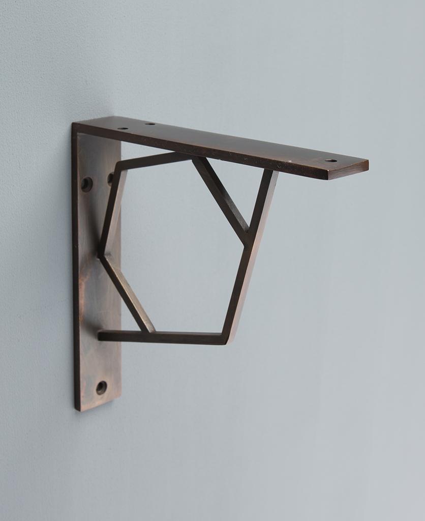 Marlene hexagon shelf bracket against grey background