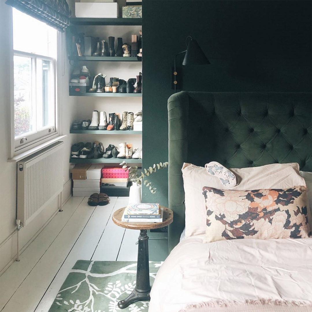 spruce things up painted bedroom with green bed and green rug