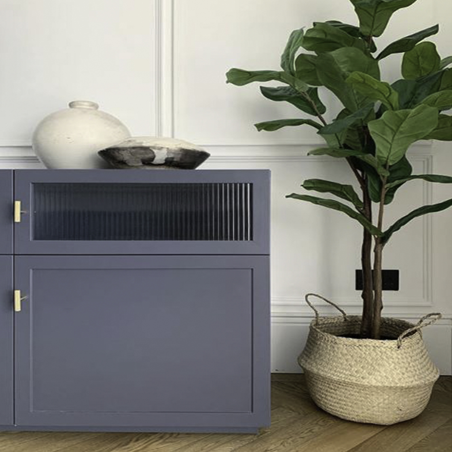 skyscraper tbar handles on blue sideboard against white wall