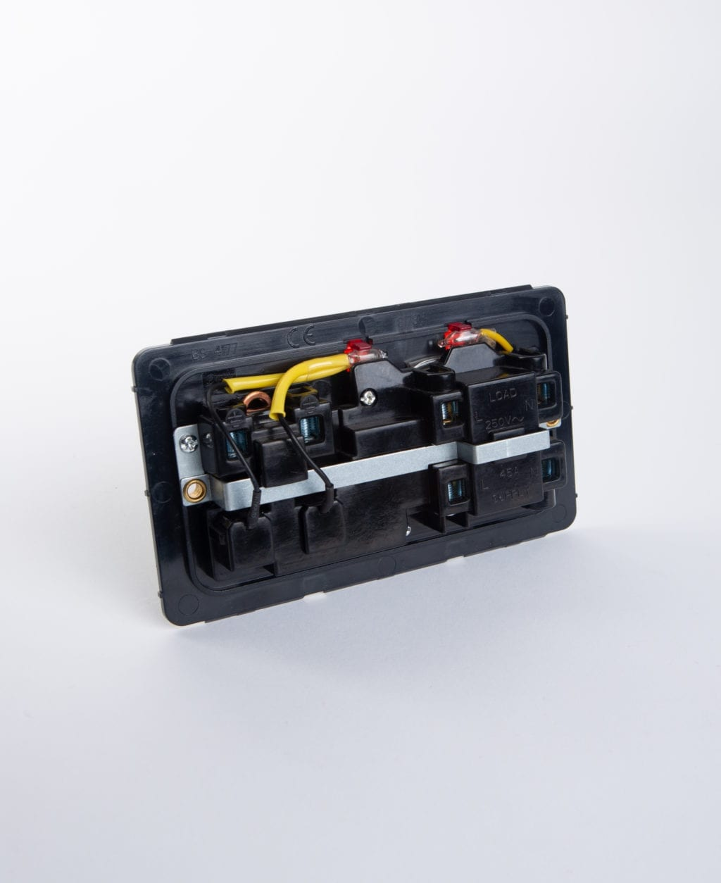 back view of 45 amp cooker isolator switch backplate against white background