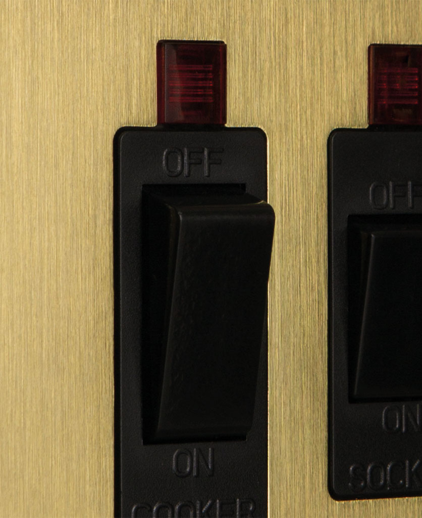 closeup of gold and black cooker switch