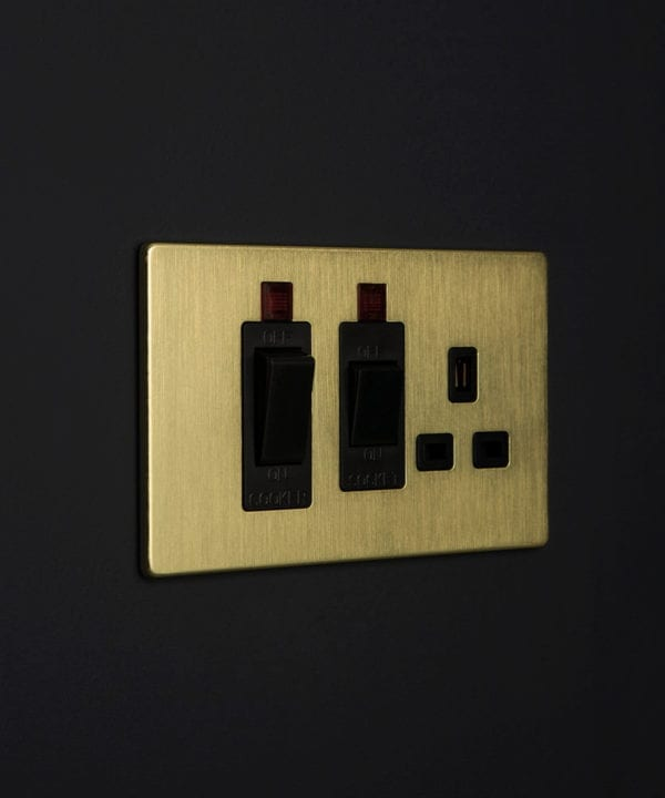 gold and black cooker switch against black background