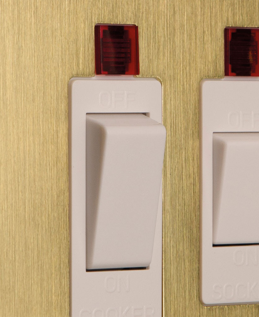 closeup of gold and white cooker switch