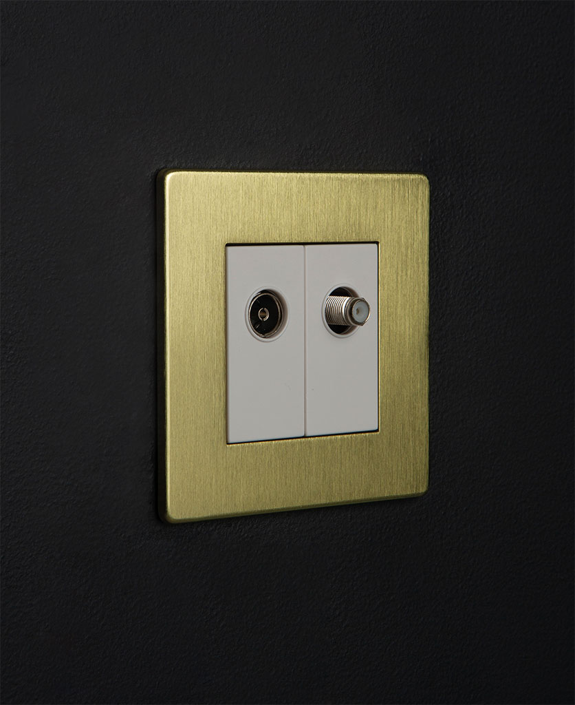 gold double port with white inserts against black background