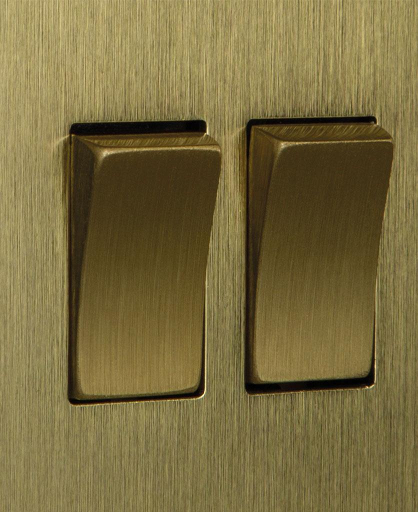 closeup of gold double rocker switch