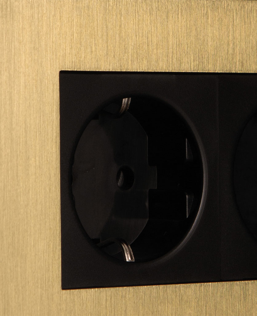 closeup of gold and black double schuko socket