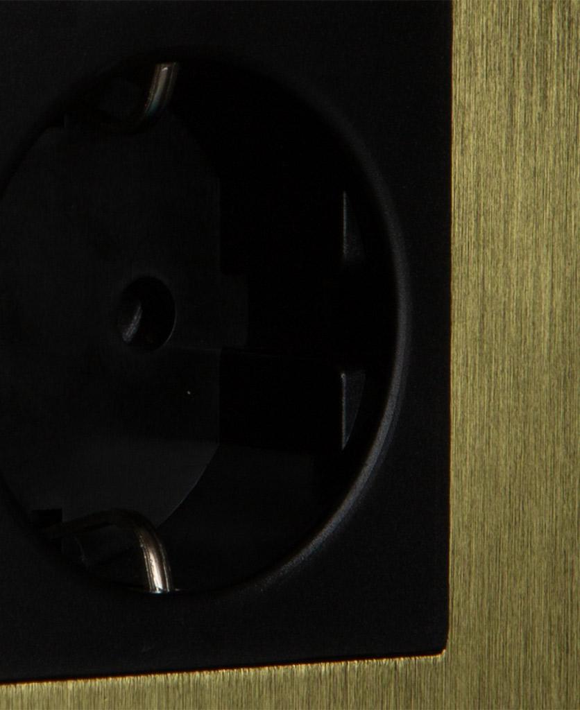 closeup of gold and black schuko socket
