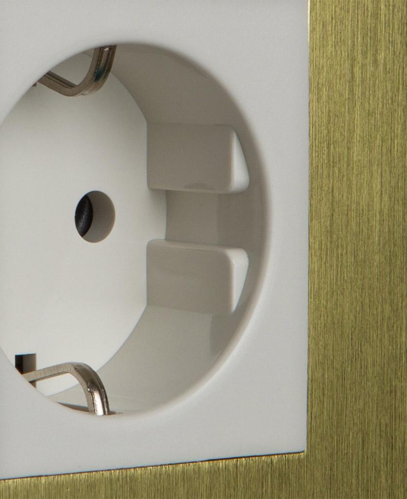 closeup of gold and white schuko socket