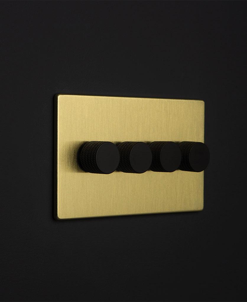 gold & black quad dimmer against black background