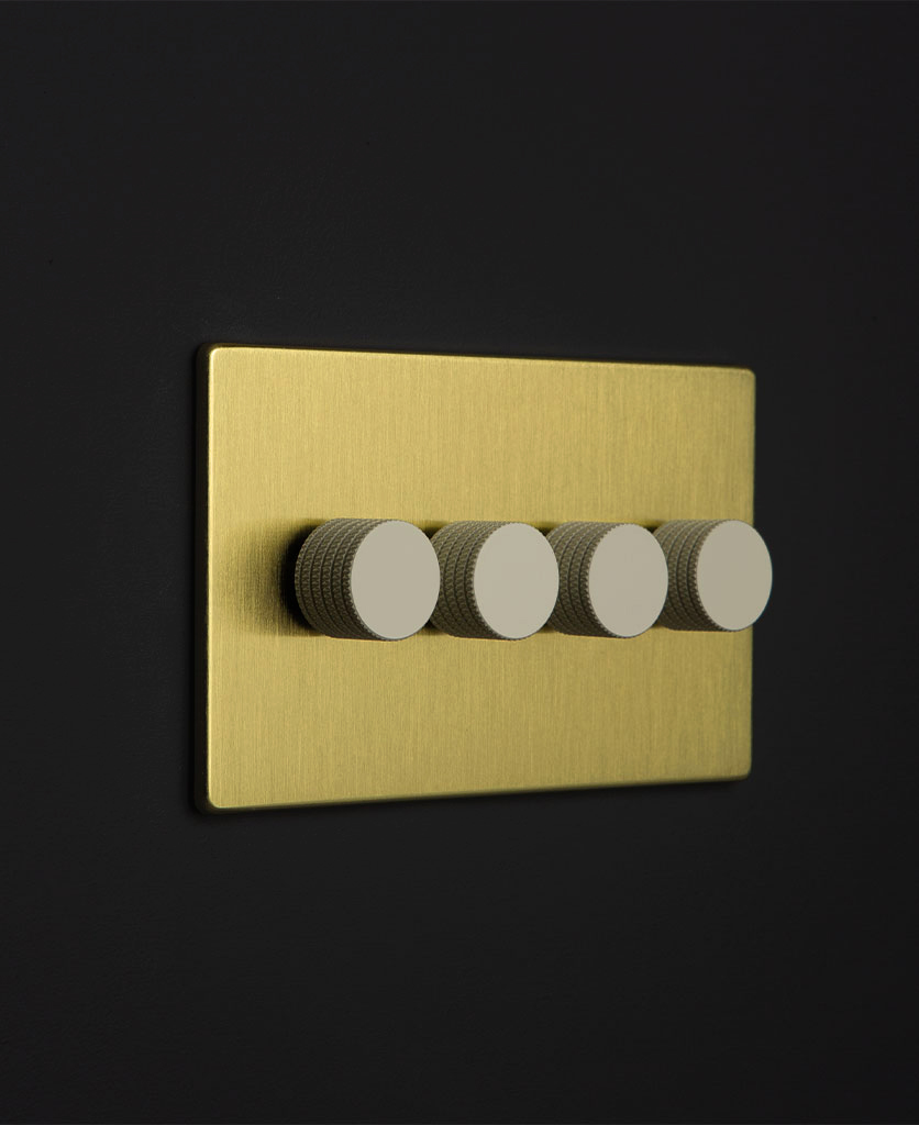 gold 4 gng dimmer switch with 4 white knurled dimming knobs