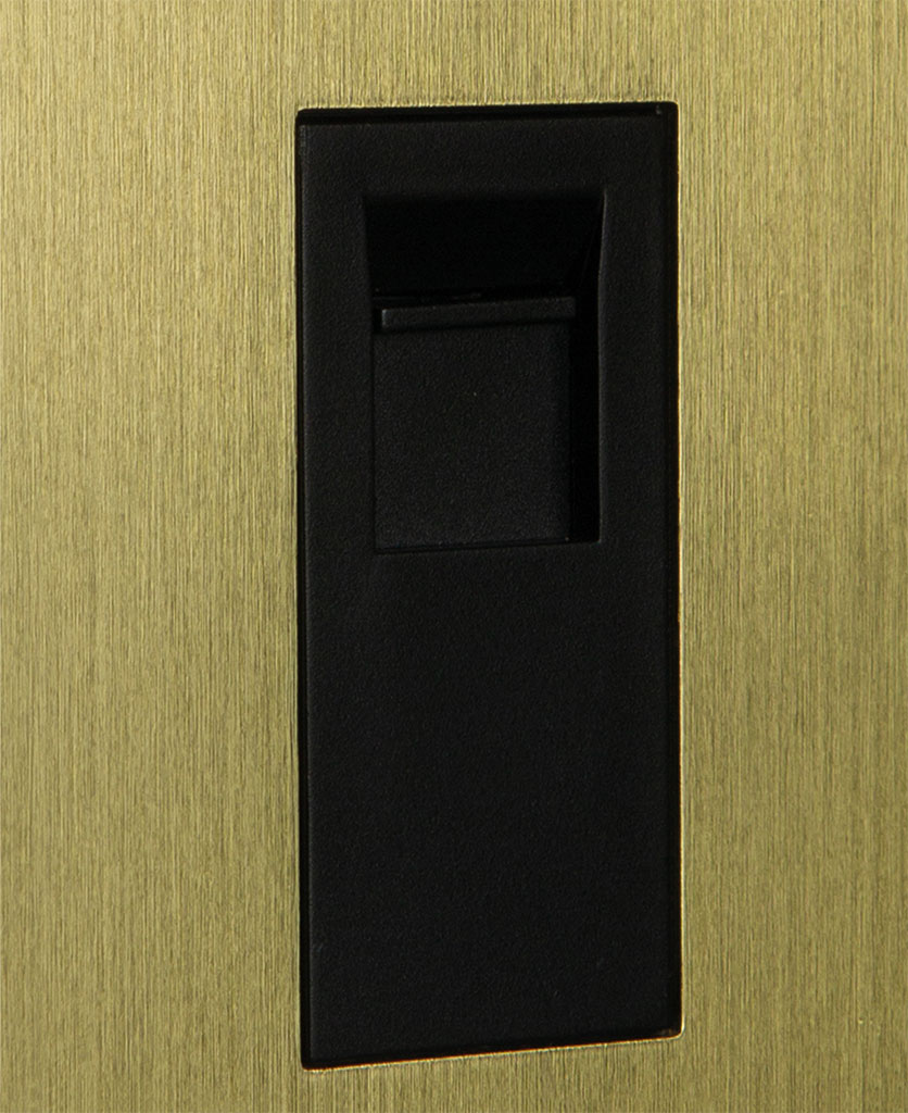 closeup of gold single port with black insert