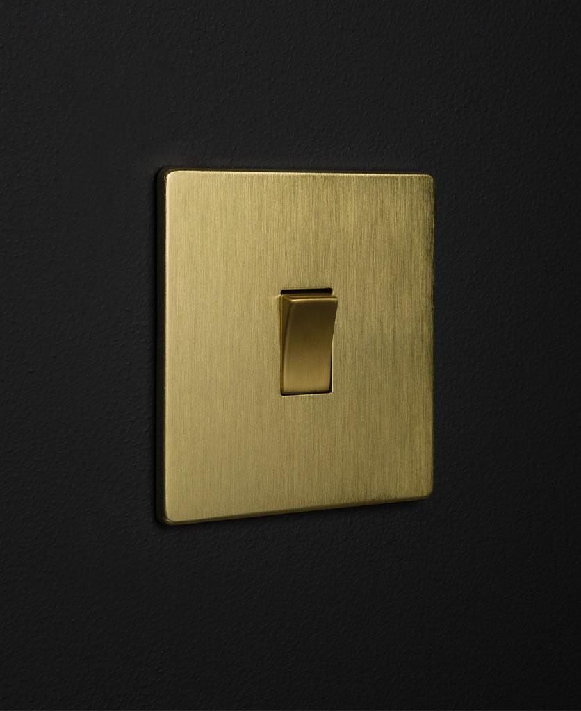 gold & gold single rocker against black wall