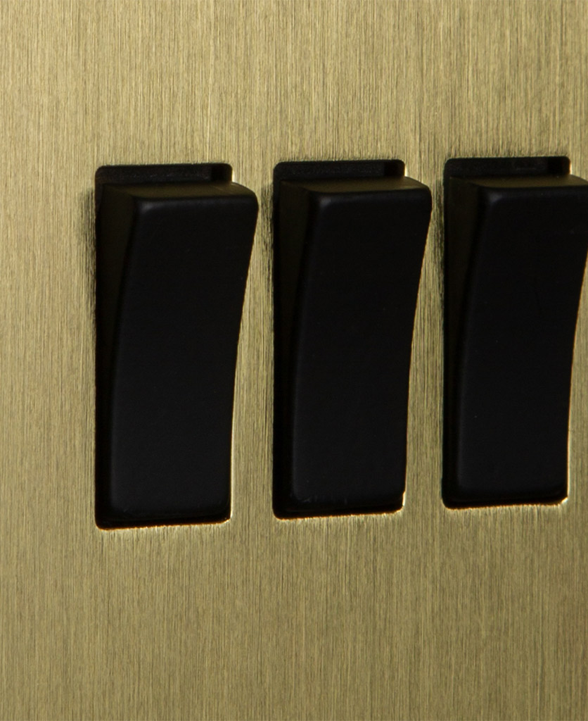 closeup of gold and black triple rocker switch