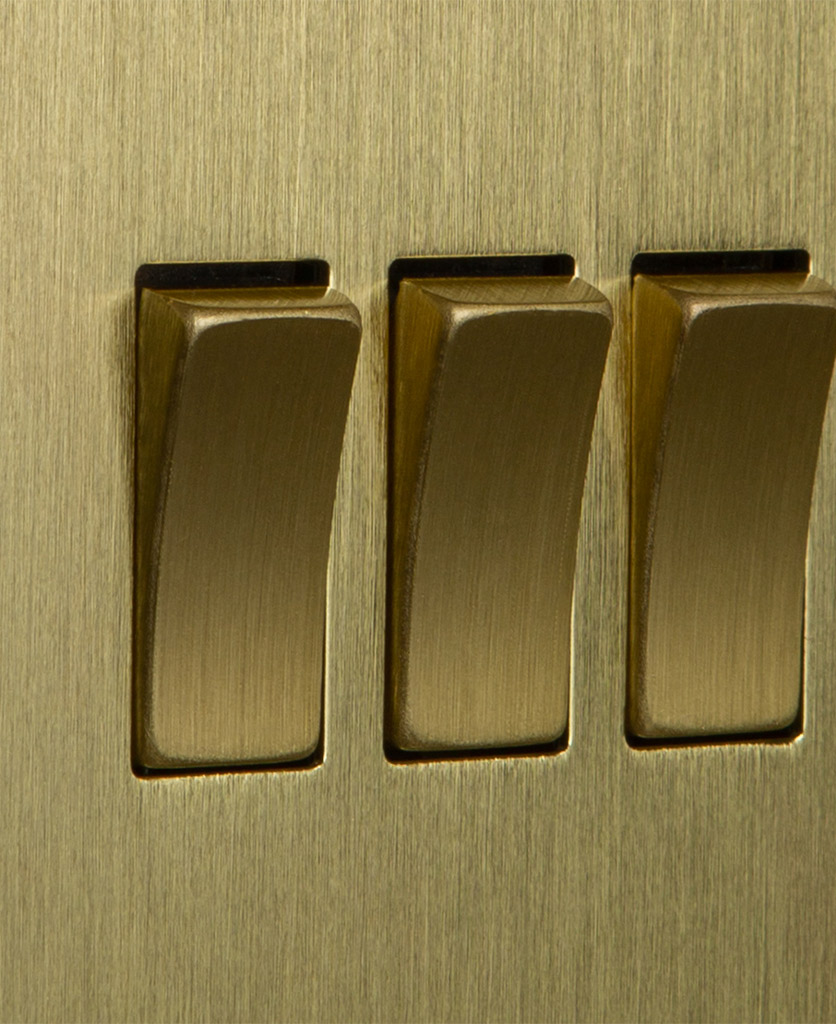closeup of gold triple rocker switch