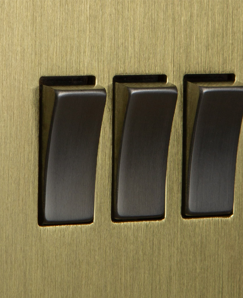 closeup of gold and silver triple rocker switch