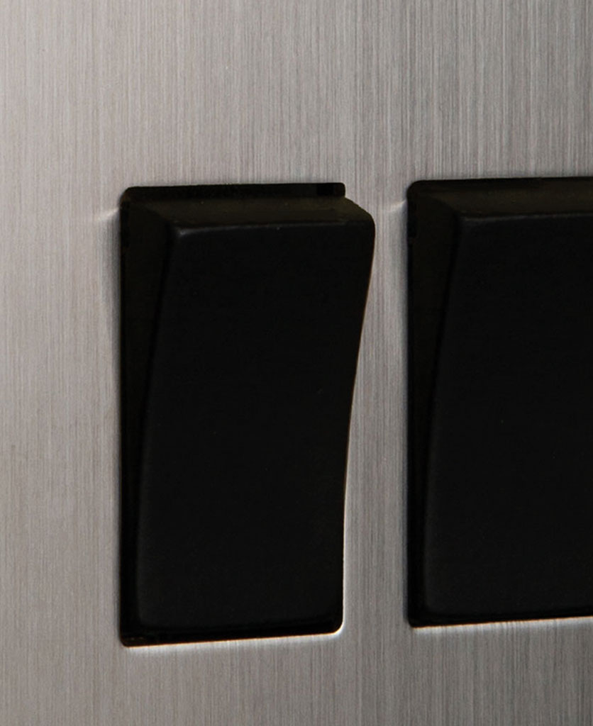 closeup of silver and black double rocker switch
