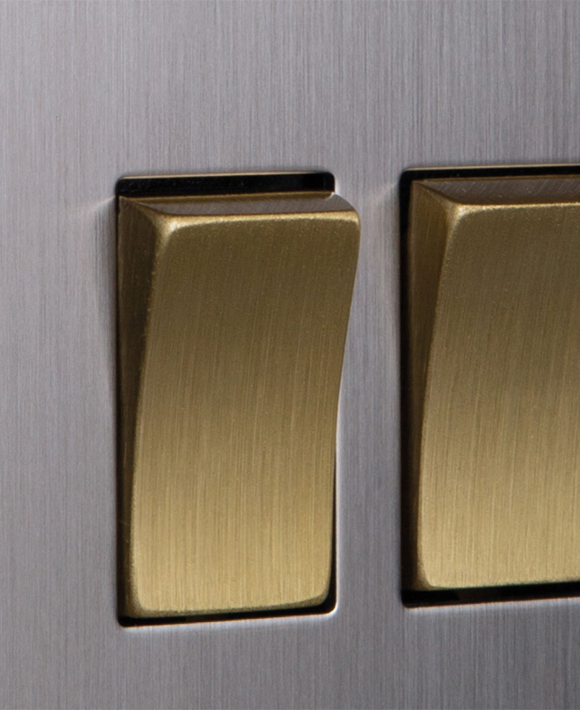 closeup of silver and gold double rocker switch