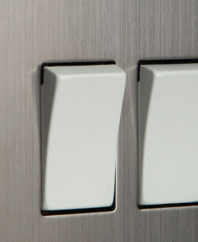 closeup of silver and white double rocker switch