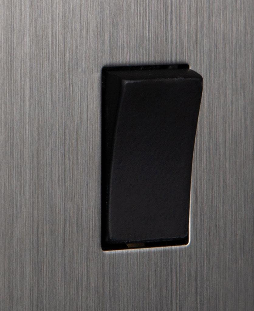 closeup of silver and black single rocker switch