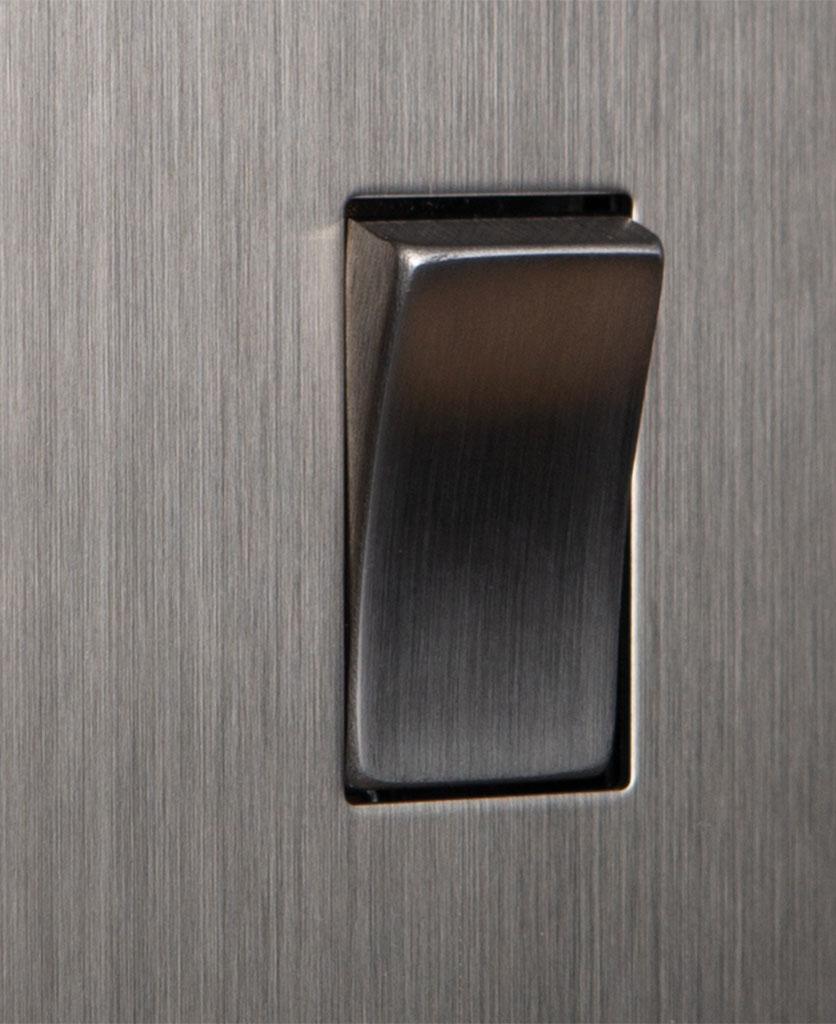 closeup of silver single rocker switch
