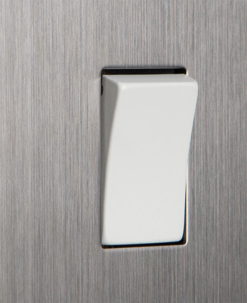 closeup of silver and white single rocker switch