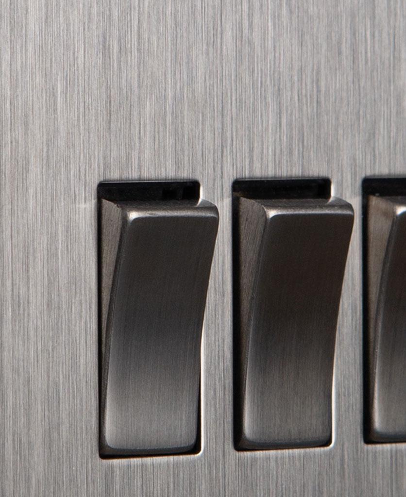 closeup of silver triple rocker switch