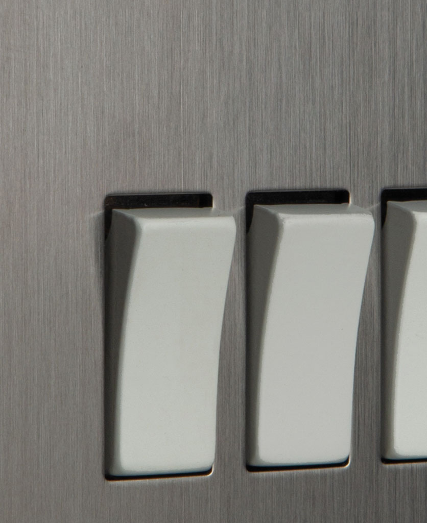 closeup of silver and white triple rocker switch