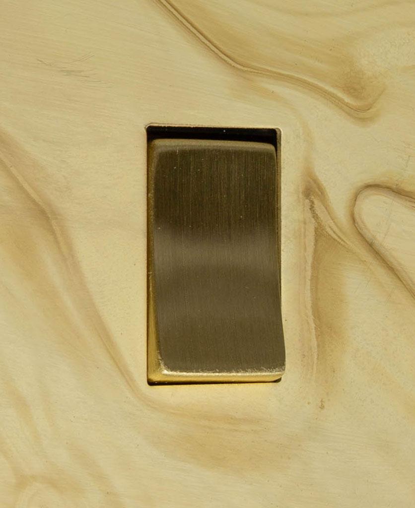 smoked gold and gold single rocker switch 2-way close up