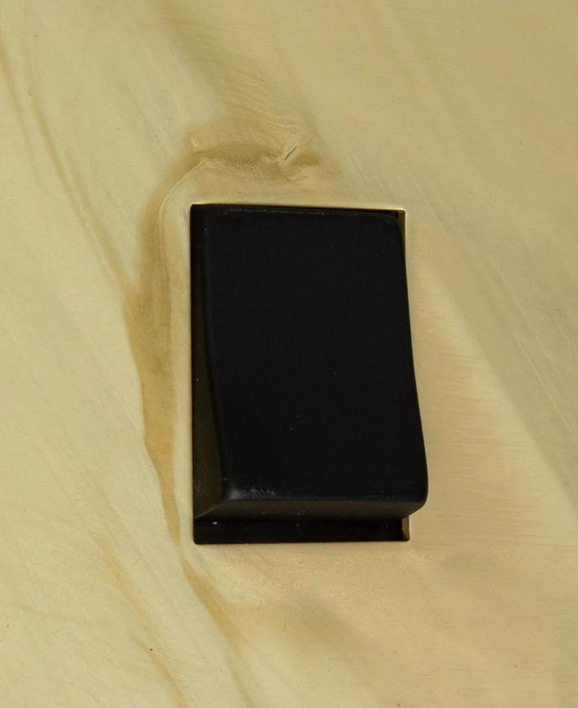 smoked gold and black single rocker switch intermediate close up
