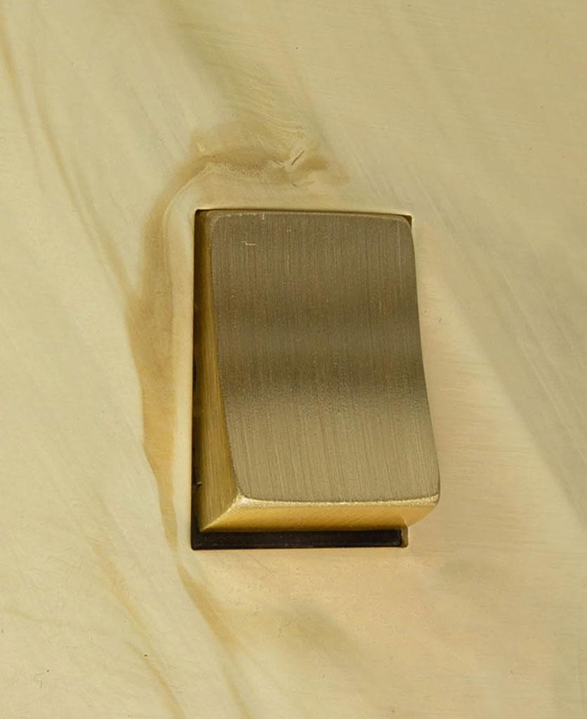 smoked gold and gold single rocker switch intermediate close up