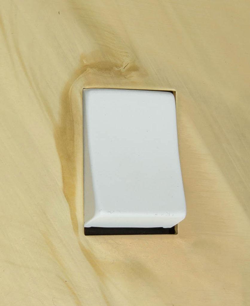 smoked gold and white single rocker switch intermediate close up