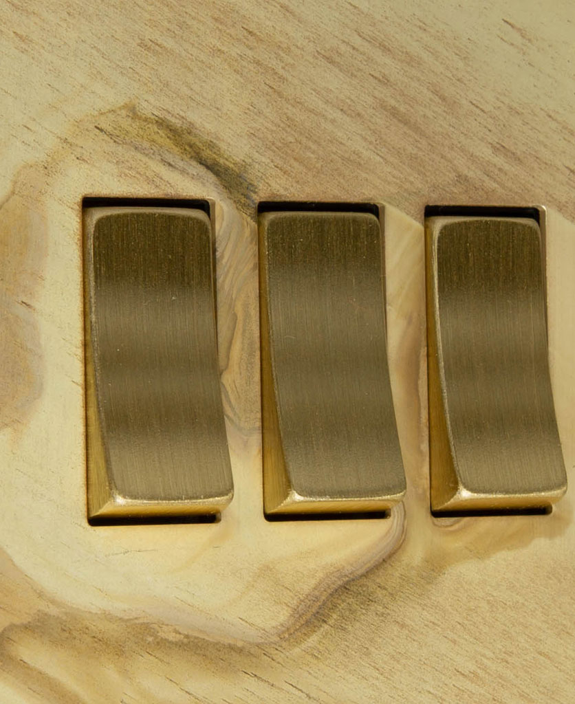 smoked gold and gold triple 3g rocker switch close up