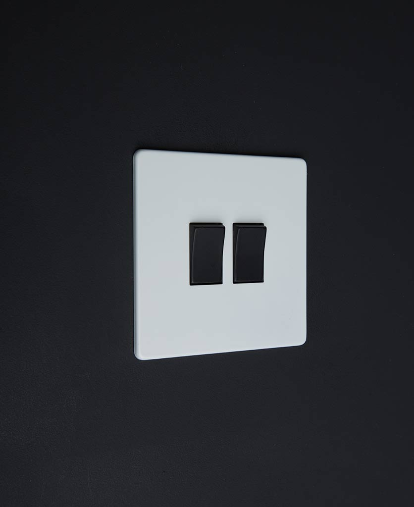 white & black double rocker switch against black background