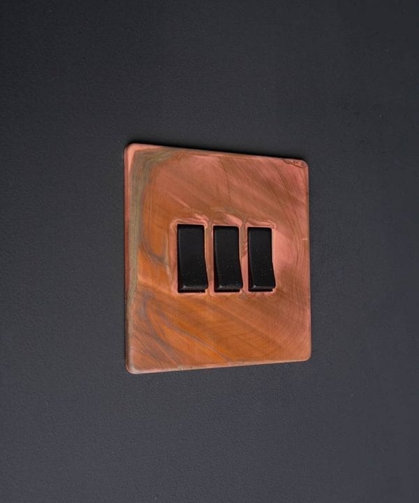 Copper and black triple rocker switch