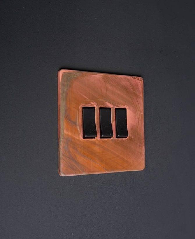Copper and black triple rocker switch