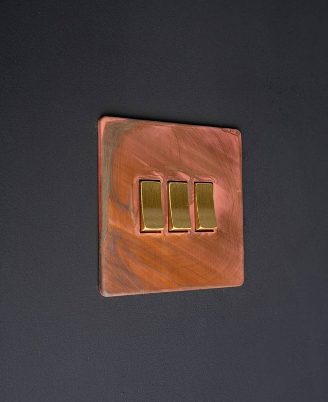Copper and gold triple rocker switch