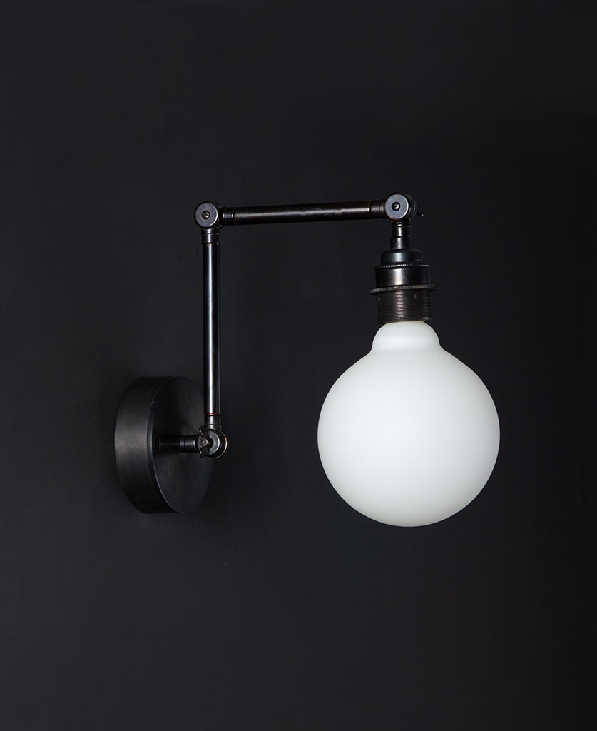 fender antique black wall light with unlit opal bulb against black background