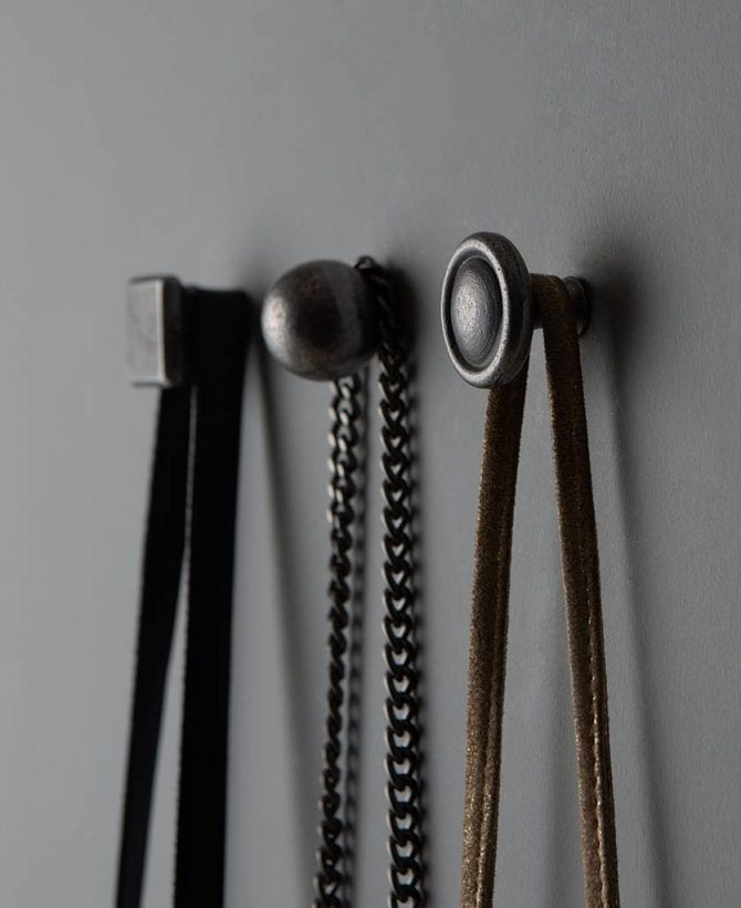 conceptual metal wall hooks