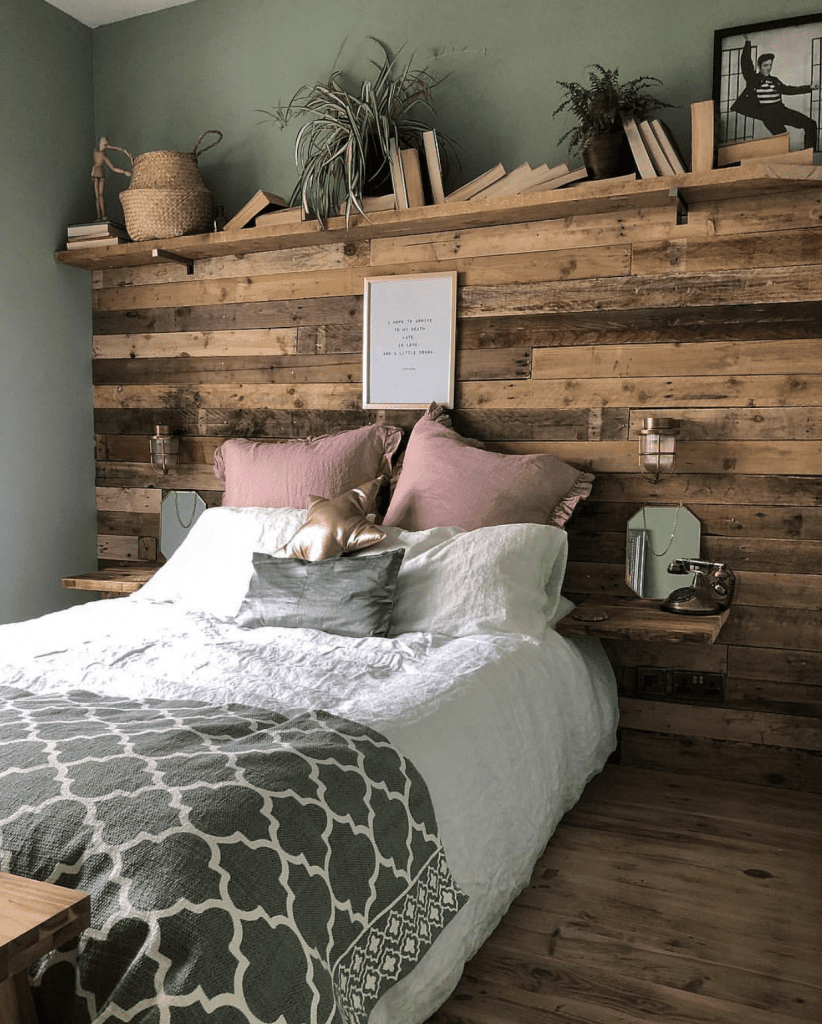 wooden panelled headboard in sage green bedroom with simon bulkhead lights either side of the bed