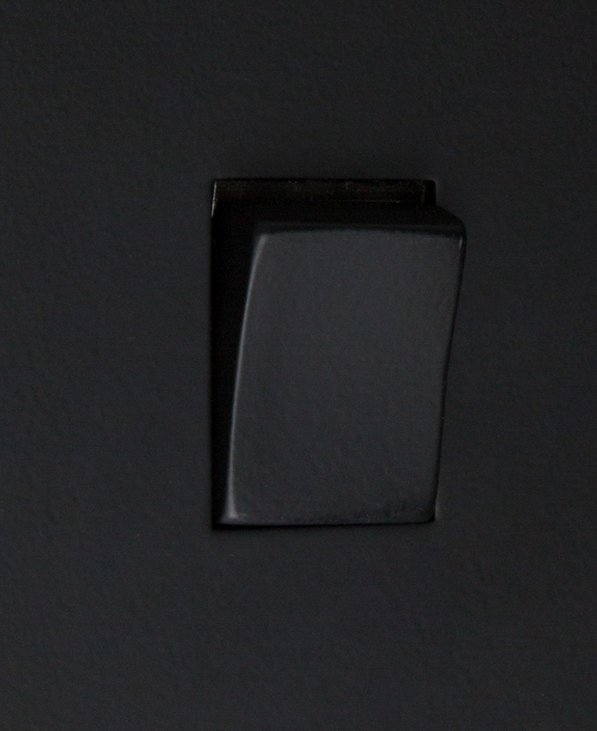 black and black 1g intermediate rocker switch close up