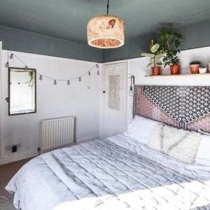 white and soft grey bedroom with white bedding